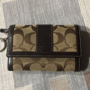 Authentic Coach small wallet with key holder.